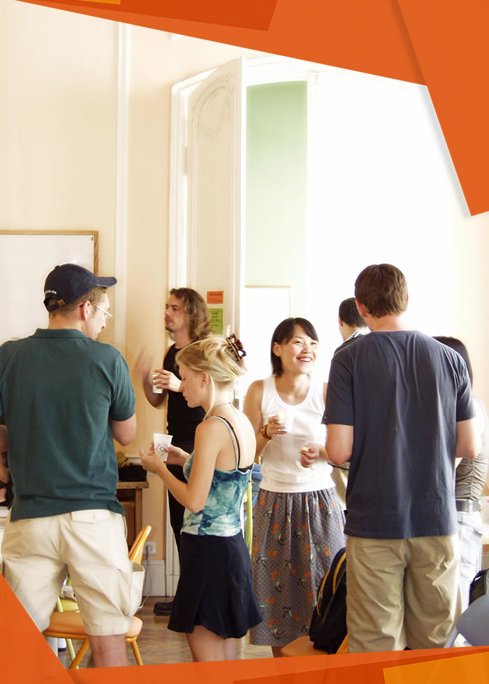 Students chatting and having fun in a sunny classroom between courses